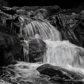 Floating with the time  by Arnab Bhattacharyya - Black & White Landscapes ( water, nature, black and white, waterscape, waterfall, floating, nature up close, landscape, stones, natural beauty )