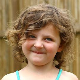 Cheeky Girl by Chrissie Barrow - Babies & Children Child Portraits ( grin, hair, portrait, girl, curls, child )