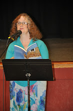 "Photo: Katherine Grace Bond reads ""On Poetry and Other Irritants."""