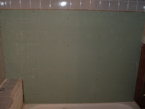 Photo: removed old moldy drywall and new green board