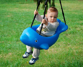 Photo: Wesley enjoying his swing in the front yard
