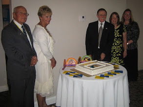 Photo: President Blaine, First Lady Nancy, new President Dennis, new First Lady Jackie, and District Governor Cynde Covington on June 5, 2010. Dennis is cutting the cake.