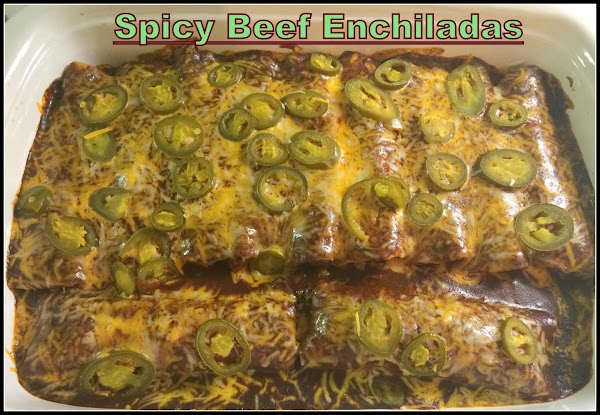 Remove from oven and use a large spatula to plate your enchiladas with some...