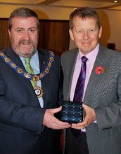 Photo: INIB President Bill Turnbull receiving a presentation from the Mayor of Limavady