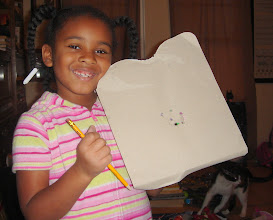 Photo: kaleya creatively figured out how to open one of her presents