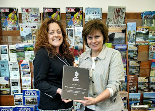 Photo: Kate Grover (Director of Membership Services) and Karen Cole (Executive Vice President) of the Bangor Region Chamber of Commerce accepting their 25 year Accreditation achievement plaque