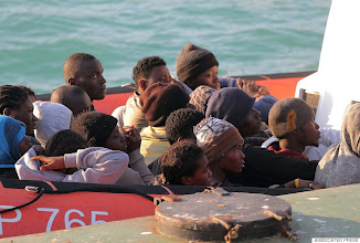 Photo: Migrants on a Coast Guard dinghy boat arrive at the Sicilian Porto Empedocle harbor, Italy, Monday, April 13, 2015. Italy's Coast Guard helped save 144 migrants Monday from a capsized boat in the waters off Libya and spotted nine bodies. It was the most dramatic of numerous rescue operations that brought thousands to safety in recent days, as good weather has encouraged the desperate to set out on smugglers' vessels. The overturned boat was spotted 80 miles north of Libya, Coast Guard Cmdr. Filippo Marini told The Associated Press in a telephone interview. (AP Photo/Calogero Montanalampo)