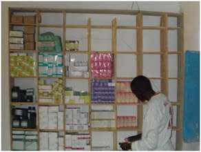 Photo: Stocking a storage shelf at the Wunlang Clinic