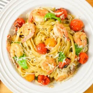 Shrimp Pasta In Walnut Basil Pesto With Roasted Tomatoes.
