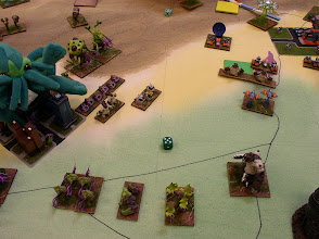 Photo: The Cthulians have destroyed many Molemen.  Only Grindix-Birvikaan (Behemoth) on right stands between the Cthulians and the Molemen Stronghold.  Plush Cthulu helps defend the Cthulian Stronghold (Left).