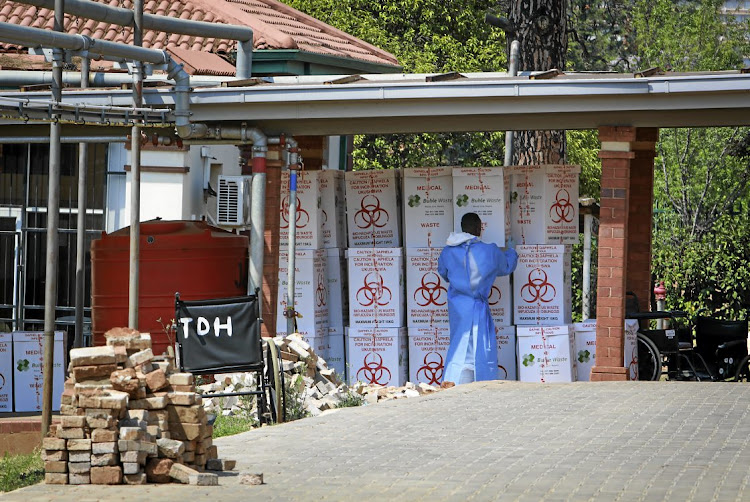 Boxes of medical waste stacked up along a corridor at the Steve Biko Academic Hospital in Pretoria on Saturday.