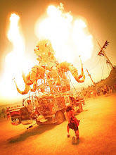 Photo: A mighty steampunk octopus belches flames into the dusk air...