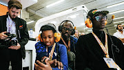 Black Coffee and his two sons at the 2019 F1 Belgium Grand Prix on Sunday