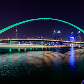 Dubai Water Canal by Mohammed Shamaa - Buildings & Architecture Bridges & Suspended Structures ( city, canon 80d, night, long exposure, water, dubai, colors, towers, canon, burj khalifa, urban, dubai water canal, buildings, uae, cityscape, skyscrapers, architecture )