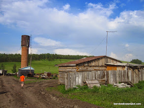 Photo: Georgy goes to ask the owners if we can study at their farm; this becomes our best site in Krasnoyarsk (Pig Farm)