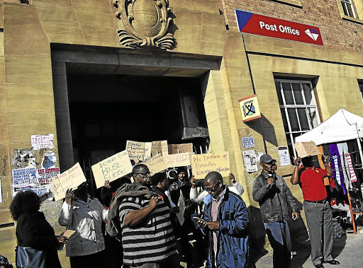 Closed for business: Post Office workers join the national strike in mid-year to demand a 12% salary increase. When the strike ended in July, 45-million mail items were piled up in post offices around SA. Picture: PILANATHI RASMENI