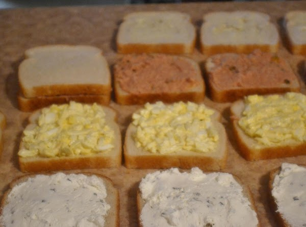To assemble:   working down each row, place the slice of white bread...