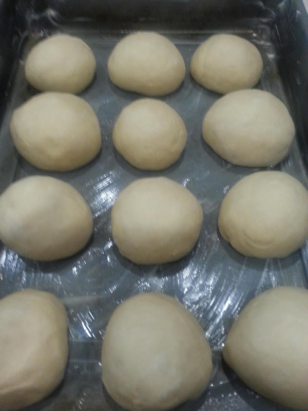 Punch down dough and shape into 12 even balls.  Place in a buttered...