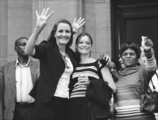 15/13/2010.Gaby Burgmer, daughter of Franz Richter, an 80-year-old man who was murdered at his Heia Safari Lodge in Muldersdrift, Johannesburg, and Gaby's daughter, Bianca Burgmer,celebrate outside  the Johannesburg  High Court after   four people accused of his murder  were given life sentences. Pic. VATHISWA RUSELO. 15/03/2010. © Sowetan.