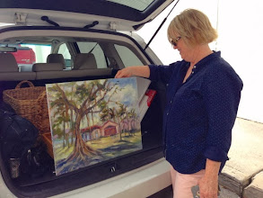 Photo: Artist Kerry Eriksen with her painting