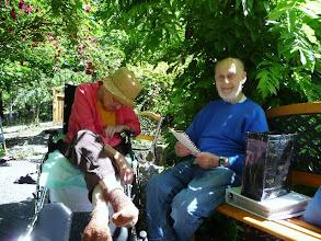 Photo: Joe reading to Lynne in the garden