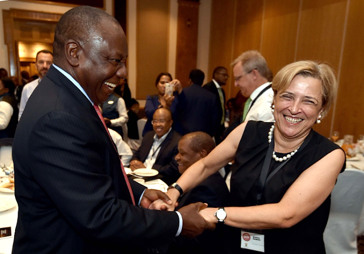 Deputy President Cyril Ramaphosa greets Absa CEO Maria Ramos at the Team South Africa breakfast ahead of the World Economic Forum annual meeting set to take place on January 23 to 26 in Davos, Switzerland. Picture: GCIS