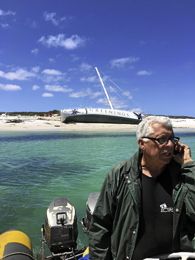 BELLY UP Salvage expert Gary Mills near the stranded Greenings yacht at Cape Point