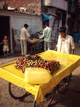 Photo: It never ceases to amaze me how vibrant India's general environment is, even in poor areas like this slum in Mumbai. Nearly missed this shot, as I was concentrating on another scene while this yellow cart seemingly appeared from nowhere. www.michiel-delange.com