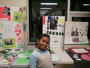 Photo: Kaleya in front of the display