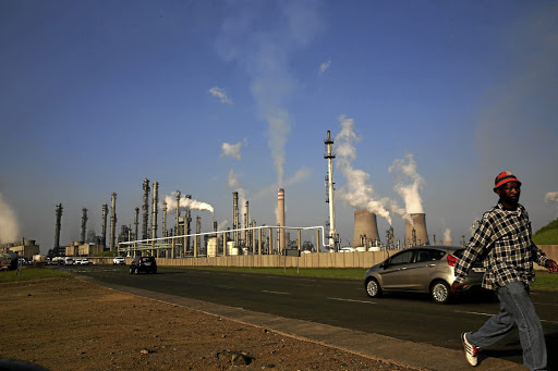 Countdown: A man walks past South African petrochemical company Sasol's synthetic fuel plant in Secunda, north of Johannesburg. The company's employees who are members of trade union Solidarity plan to down tools. Picture: SIPHIWE SIBEKO/REUTERS