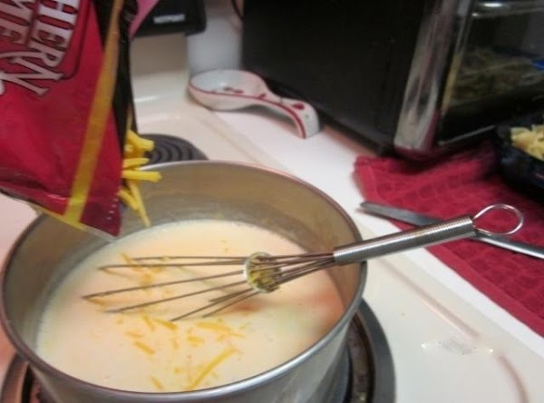 Stir in 3 cups cheese and heat (reserve 1 cup for top) stirring with...