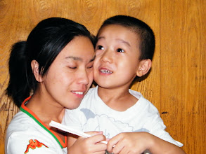 Photo: baby son, warrenzh, 朱楚甲, and his mom, emakingir, amid dinner in a restaurant.