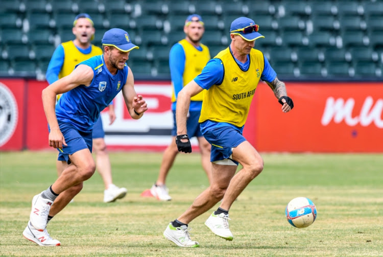 Dale Steyn (R) and Wiaan Mulder (L) of the Proteas take part in a football session during the South African national cricket team training session and interviews at Bidvest Wanderers Stadium on September 27, 2018 in Johannesburg.