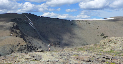 Photo: John approaching Otokami - There's our route in the background (right to left along horizon).