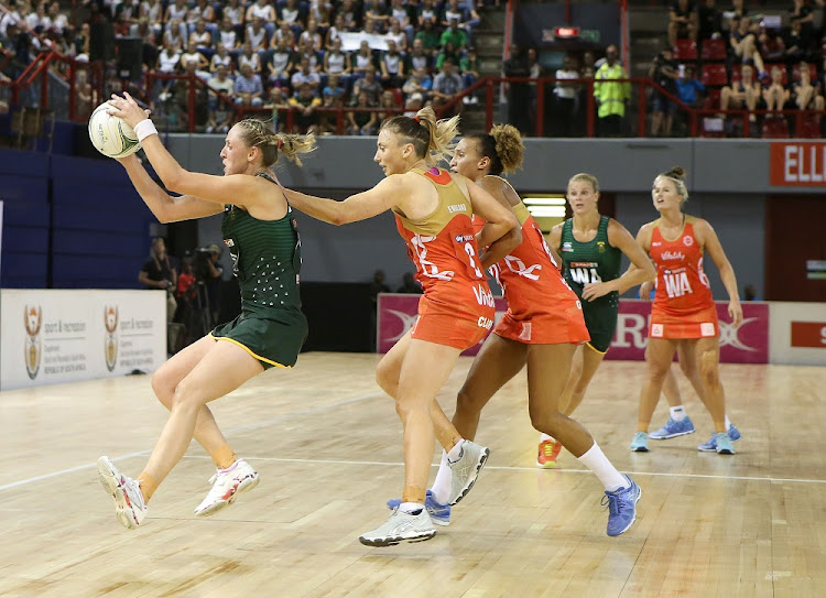 Erin Burger of the Spar Proteas (left) and Jade Clarke in action at the Netball Quad Series match between South Africa and England at Ellis Park Arena in Johannesburg in January. Picture: GALLO IMAGES