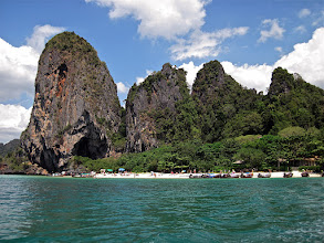 Photo: white-sand beach backed by limestone karsts, Krabi coastline