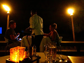 Photo: The view from our outdoor table at Heliconia. It was also movie night. You can see the screen in the corner.