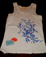 """Photo: Old Navy white maternity tank. Very clean but has a small area where hem is coming undone. Could be easily fixed/repaired. Says """"Here Comes Happiness"""" on the baby belly and the label that is sewn on the front says """"Everyday holds new promise"""" $5 XL"""