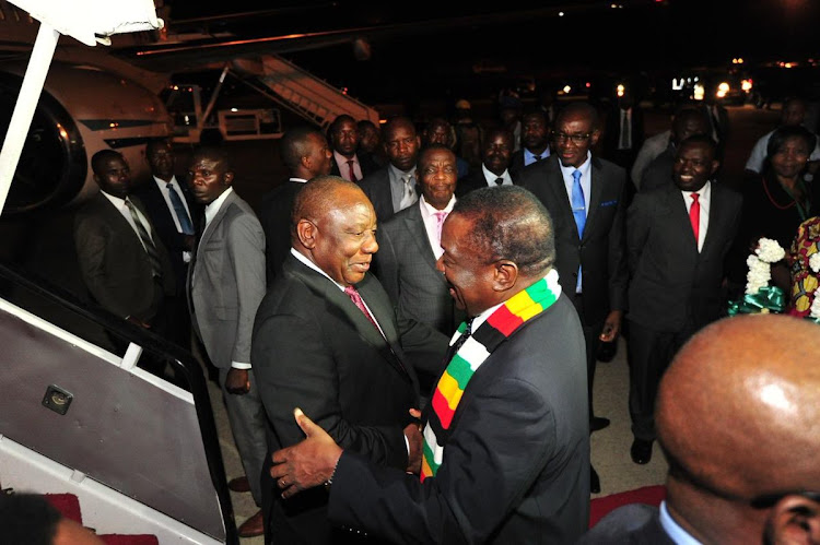President Cyril Ramaphosa, left, was greeted by Zimbabwean president Emmerson Mnangagwa on arrival in Harare to attend a bi-national summit.