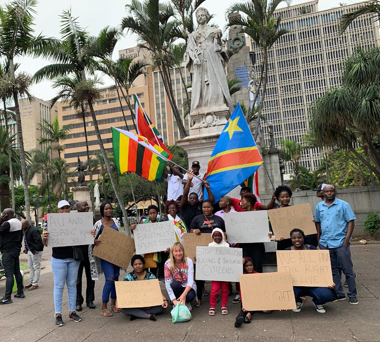 Foreign nationals gathered outside Durban's City Hall on Saturday to protest against violence in Zimbabwe