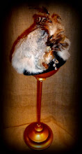 Photo: <KAPELUXE> Unique-Chique Hats by Luba Bilash ART & ADORNMENT  Midnight black wool felt base; rabbit fur; multifeathered; silver plate beads 360 degree possibilities. Can also be worn on an angle. Size L - 56 cm/22 in $85 SOLD