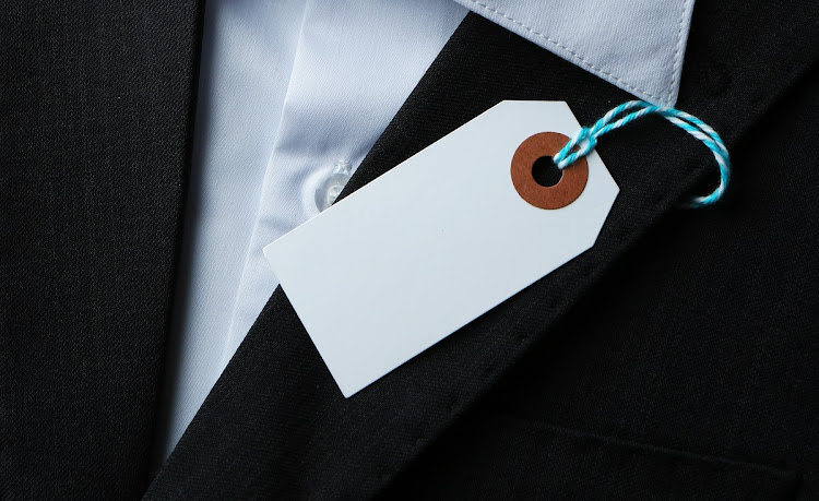 A close-up image of a price tag on white shirt and black jacket. Picture: 123RF/SEREZNIY