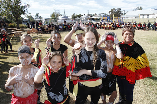 The school community gathered to watch a display of dance and music presented by the Kamilaroi Choir and Dance Group to celebrate Aboriginal culture, part of NAIDOC activities yesterday. Among the performers, tutored by Narrabri Public School's Aboriginal Education Officer Pattie Lettice were some of the group depicting animals in traditional dance, back, from left, Krista Zarka, Halle Rooney, Clarence Morgan Glasserles, Mark Dennis, front, Declan Rooney, Menzie Baker-Harvey and  Kaitlyn Walton with Pattie Lettice.