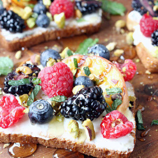 Sweet Berry & Grilled Peach Toast w/ Crushed Pistachios, Honey, Mascarpone, & Mint.