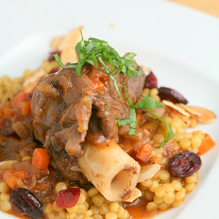 Braised Lamb Shanks and Saffron Pearl Couscous with Cranberries and Almonds
