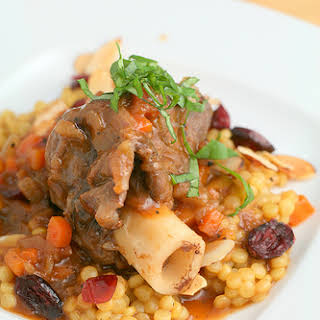 Braised Lamb Shanks and Saffron Pearl Couscous with Cranberries and Almonds.
