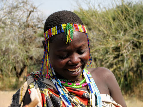 Hadzabe woman with colorful beads