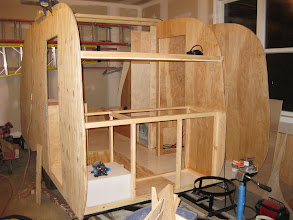 Photo: From the front, the Kitchen framing and wall for the bathroom in place.