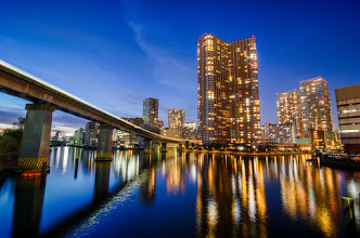 Photo: The Tokyo Monorail passes over the waters of Tokyo Bay in Tokyo's Minato Ward