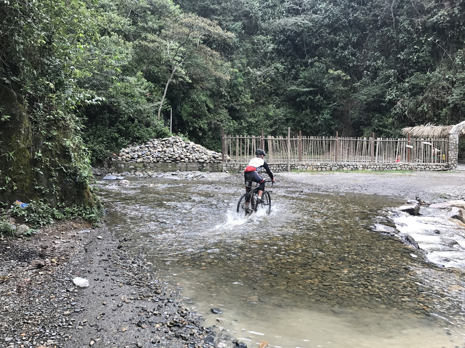 Cyclist crossing river on Death Road